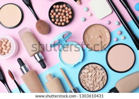 Flat lay composition with skin foundation, powder and beauty accessories on color background #1303610431