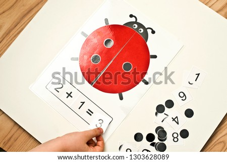 ladybug table game. logical excersice. dots and numbers. create your own mathematical equation. implement for primary school and children with disabilities. #1303628089