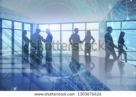 Silhouettes of business people working in panoramic office with double exposure of hud interface and business infographics. Toned image #1303676626