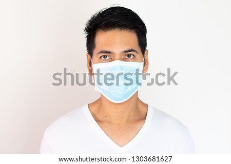 Asian  men in casual  wear surgeon mask for protection   from situation of Bangkok pm 2.5 dust pollution from Thailand and covid19  #1303681627