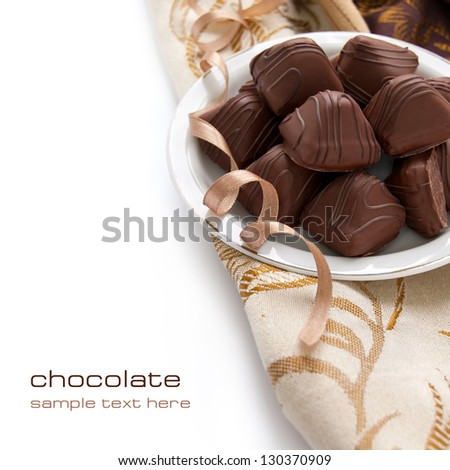 Chocolate candy with sweet cream inside on the white background #130370909