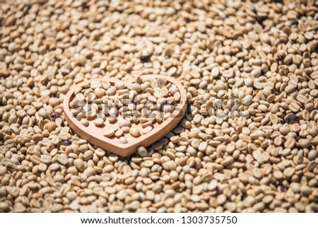 coffee seed dry out with wood heart background #1303735750