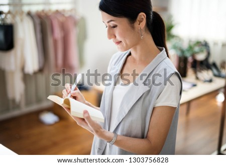 Fashion designer is working on a project #1303756828