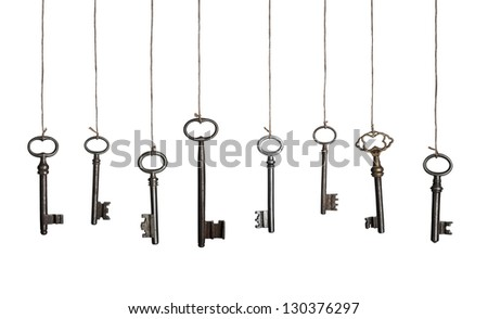 Old keys on strings, hanging in a row. Isolated on white. #130376297