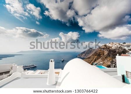 Amazing cloudy sky and beautiful view in Santorini, Greece #1303766422