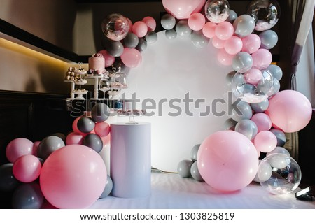 Delicious wedding reception. Birthday Cake on a background balloons party decor. Copy space. Celebration concept. Trendy Cake. Candy bar. Table with sweets, candies, dessert. #1303825819