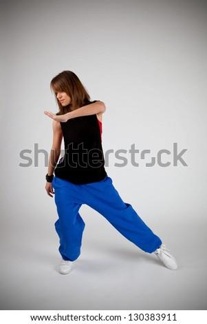 young smiling girl dancing hip-hop #130383911