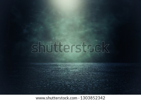 Spotlight over concrete floor. dark black background #1303852342
