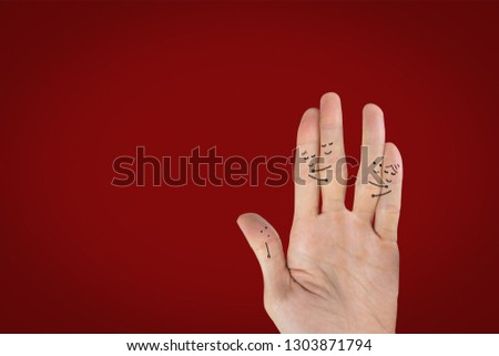 Love and lonely concept. Hand draw cartoon two love couples and alone on palm hand on red background and space. Valentine's day concepts.