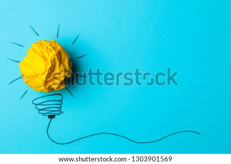 Concept creative idea. concept of creative idea. Crumpled paper balls and painted light bulb on bright background. metaphor, inspiration. #1303901569