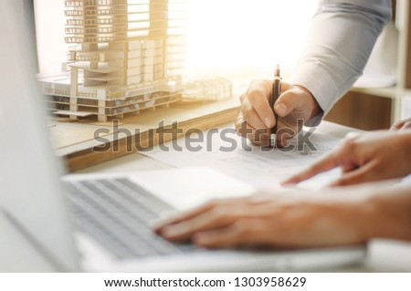 engineer architecture working with blueprint discussing about building #1303958629