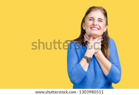 Beautiful middle age mature woman wearing winter sweater over isolated background shouting and suffocate because painful strangle. Health problem. Asphyxiate and suicide concept. #1303980511
