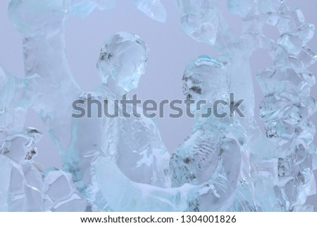 """Izhevsk, Russia - February 2, 2018: Ice sculpture """"Tree of Life"""". Exhibition of ice figures in Izhevsk. Man and woman. Close-up. Background. #1304001826"""