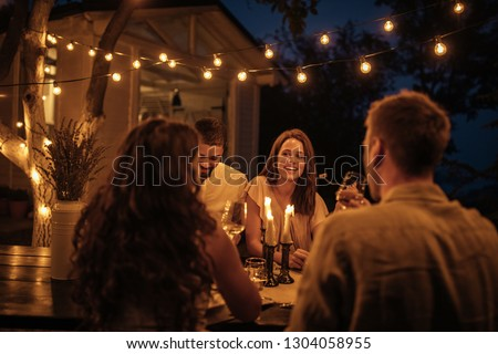 Shot of friends having fun at a dinner party in a backyard #1304058955