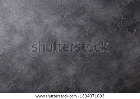 Natural black slate stone background pattern with high resolution. Top view. Copy space. Royalty-Free Stock Photo #1304071003