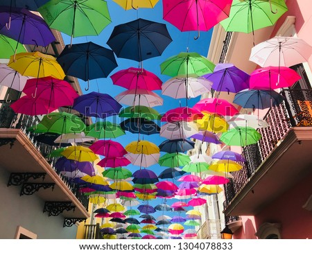 Bright Umbrellas handing above the street in Old San Juan Puerto Rico Royalty-Free Stock Photo #1304078833