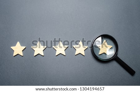 Five stars and a magnifying glass on the last star. Check the credibility of the rating or status of the institution, hotel, restaurant. Auditing, testing and certification. Getting the fifth star. #1304194657