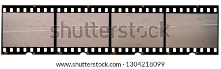 long 35mm film strip or 135 film material on white background, real scan no macro photo, 4 empty photo placeholder  #1304218099