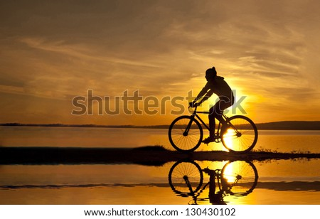 silhouette of a cyclist at sunset #130430102