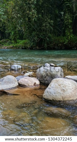 Rocks underwater on riverbed with clear freshwater #1304372245