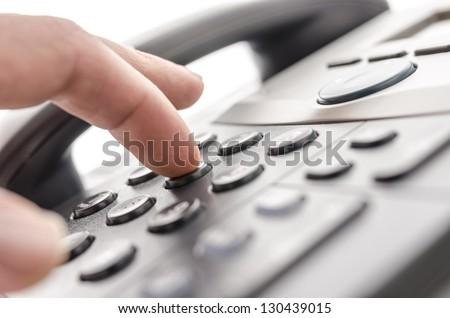 Detail of using a telephone keypad. Shallow dof. #130439015