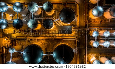 Liquid chemical tank terminal, Storage of liquid chemical and petrochemical products tank, Aerial view at night. #1304391682