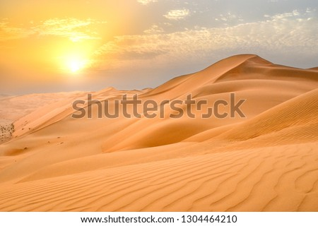Sunset at the Edge of the Rolling Sand Dunes in the Empty Quarter (Arabian Desert) outside Abu Dhabi, United Arab Emirates #1304464210