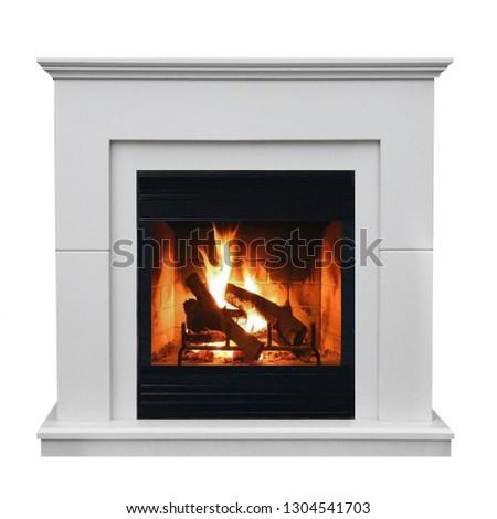 Burning gas fireplace isolated on white background. #1304541703