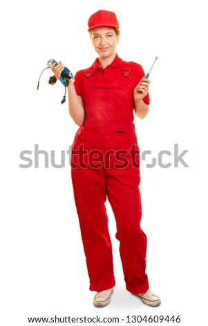 Young woman is doing training as an electrician or electrician #1304609446