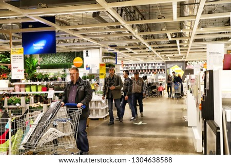 Kazan, Russia - Oktober 17, 2018: Interior of large IKEA store with a wide range of products in Russia. Flowers #1304638588