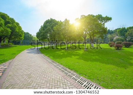 Green areas and woods in city parks #1304746552