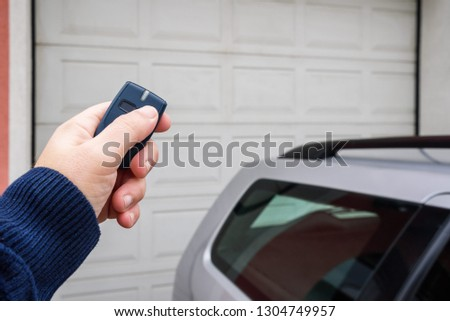 Garage door PVC. Hand use remote controller for closing and opening garage door  #1304749957