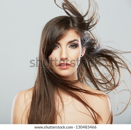 Woman face with hair motion on white background isolated close up portrait. #130483466