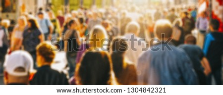 crowd of people in a shopping street #1304842321