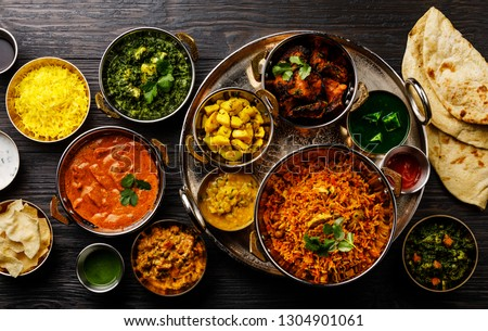 Indian food Curry butter chicken, Palak Paneer, Chiken Tikka, Biryani, Vegetable Curry, Papad, Dal, Palak Sabji, Jira Alu, Rice with Saffron on dark background #1304901061