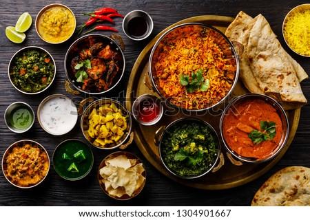 Indian food Curry butter chicken, Palak Paneer, Chiken Tikka, Biryani, Vegetable Curry, Papad, Dal, Palak Sabji, Jira Alu, Rice with Saffron on dark background #1304901667