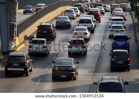 MEXICO CITY, MEXICO - FEBRUARY 3 2019 - Mexican metropolis with more than 25 milions of inhabitants mexico city street are every day a traffic jam #1304953534