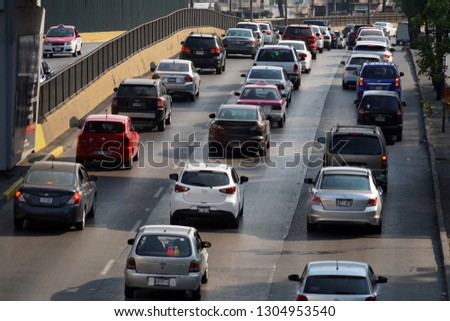 MEXICO CITY, MEXICO - FEBRUARY 3 2019 - Mexican metropolis with more than 25 milions of inhabitants mexico city street are every day a traffic jam #1304953540