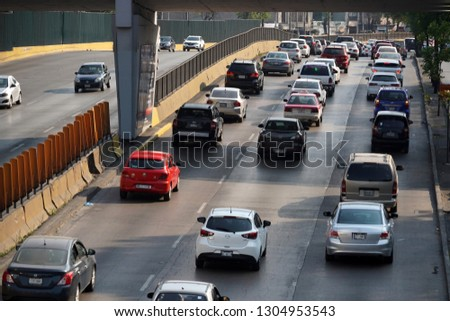 MEXICO CITY, MEXICO - FEBRUARY 3 2019 - Mexican metropolis with more than 25 milions of inhabitants mexico city street are every day a traffic jam #1304953543