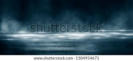 Wet asphalt, reflection of neon lights, a searchlight, smoke. Abstract light in a dark empty street with smoke, smog. Dark background scene of empty street, night view, night city. #1304954671