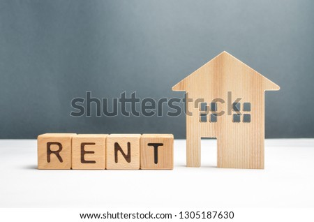 Wooden figurine houses and cubes with the word rent. Search for housing for rent or property rental. The concept of finding a roommate and making money on unused homes. Investments. Mobile nation #1305187630