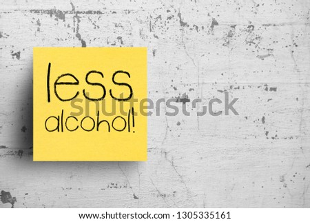 Sticky note on concrete wall, Less alcohol #1305335161