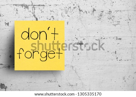 Sticky note on concrete wall, Don't forget #1305335170