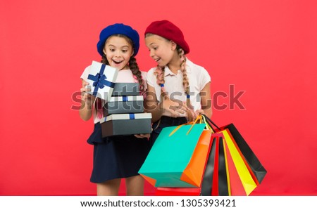 Shopping and holidays. For my dear friend. Girl giving gift box to friend. Girls friends celebrate holiday. Children formal wear with gift box. Open gift now. Friendship concept. Birthday present.
