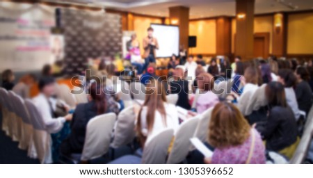 Banner of blurred image of seminar room with participants about life insurance business #1305396652