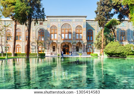 Beautiful view of the Golestan Palace and scenic pond with emerald water in Tehran, Iran. The Golestan Palace is a popular tourist attraction of the Middle East. Traditional Persian exterior. #1305414583