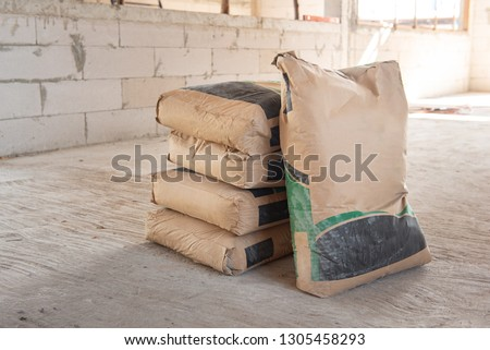 Pile of Cement in bags, stacked for a construction project. Royalty-Free Stock Photo #1305458293