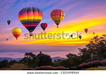 Colorful hot air balloons flying over mountain at Huai Nam Dang National park in sunrise and beautiful sky in morning, Chiang Mai, Thailand. #1305498964