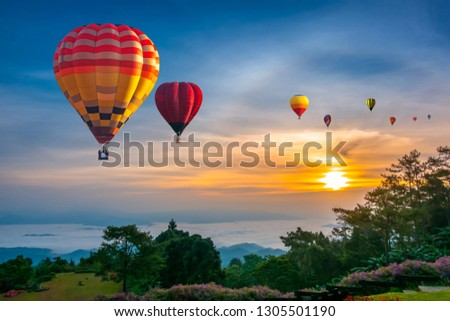 Colorful hot air balloons flying over mountain at Huai Nam Dang National park in sunrise and beautiful sky in morning, Chiang Mai, Thailand. #1305501190