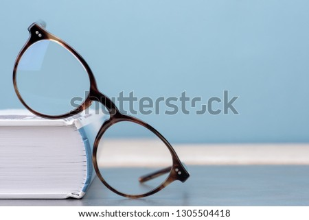 Glasses with book education and knowledge concept picture